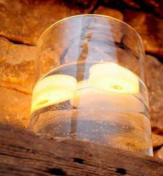 floating candles huge cylinder vase events weddings parties decor via beehive events