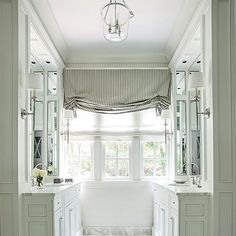 White marble and strategically placed mirrors transformed this once claustrophobic master bath.