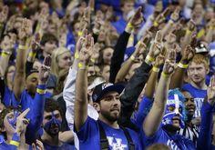 Fans mockingjay-saluting Josh Hutcherson at a Kentucky basketball game.