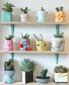 Plant shelf. A beautifully curated collection of one of a kind plant pots to create this plant wall. Tempted to create one yourself?Find out who the designers are. This was an exhibition at the London Design Festival 2015.
