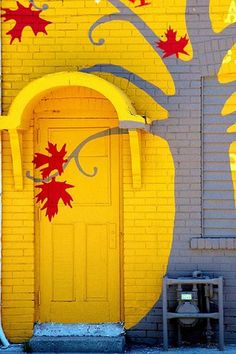 Playfully-painted yellow doorway.