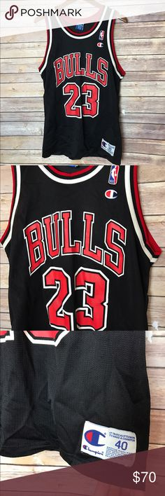 "90s MICHAEL JORDAN Champion CHICAGO BULLS Jersey Vintage 90s Michael Jordan Chicago Bulls Jersey  Loose threading on bottom. Otherwise great used condition.  Black with red and white print  Size 40 but also adhere to measurements below: Armpit to armpit 20"" Length 29"" Champion Shirts"