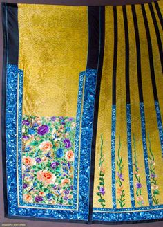 EMBROIDERED SILK SKIRT, CHINA, 19TH C Gold silk open weave damask, blue floral embroidery on black border bands, center panels of butterflies & peonies in purple, blue, pink, & green