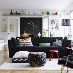 Black sofa. Velvet makes it reflective makes it appear lighter