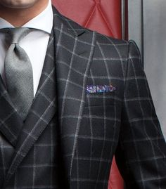 Plaid three-piece. With a splash of pocket square color.