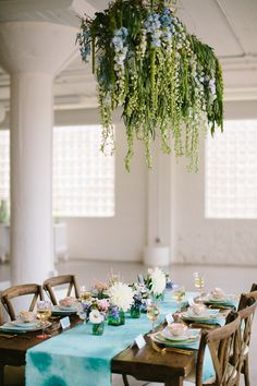 "suspended ""chandelier"" constructed out of varying shades of blue delphinium and lime-green amaranthus, all hanging from a manzanita branch to create a perfectly whimsical & dreamy enclosure for monet inspired styled shoot for chicago wedding via life in bloom chicago blog"