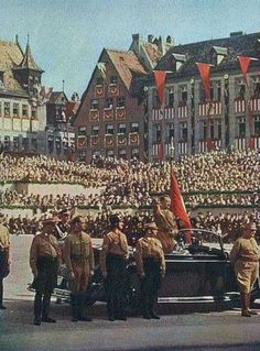 Adolf Hitler at a National Socialist parade in Germany.