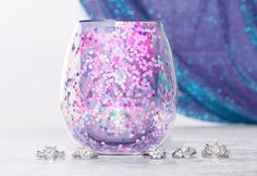 DescriptionShippingFragranceSo mermazing! Our Limited Edition Mermaid candle is full of sparkle and wonder. Light this candle and dive right into the mesmerizing citrus, blue marine and soft lavender scent! When you've finished burning, reveal an exclusive, 925 Sterling Silver ring inside and re-... Charmed Aroma Candles, Charmed Aroma Rings, Glitter Jars, Glitter Candles, Mermaid Ring, Mermaid Glitter, Wine Glass, Glass Vase, Candle Rings