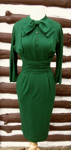 Globes and Maps 1960s Long Sleeve Green Dress with Bow/Button Detail. $55.00, via Etsy.