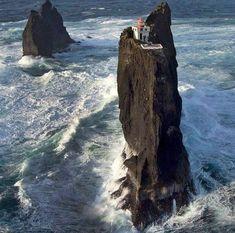 The beautiful Þrídrangar Lighthouse, Vestmannaeyjar Islands, Iceland