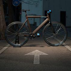 matte chocolate brown fixie bike black saddle black wheels outdoor night photography