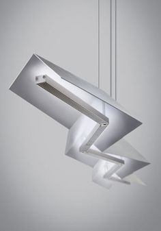 Jorn Linear Suspension features sharp angles that create a daring, structured light sculpture sure to make a modern statement in any space. Available in satin nickel or black finish. 47 watts of LED face up towards the matte white inner metal shade providing a glare free wash of indirect light (2350 lumens, 3000K). Dimmable with low voltage electronic dimmer. 54.8L x 4.25H.