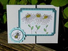 """I used a Penny Black stamp for the main flowers. I decided to leave them like a daisy. Then I used the bee from """"In Full Bloom"""" for the circle part to keep it closed. This joy fold card is so much fun to do! Joy Fold Card, Fun Fold Cards, Folded Cards, Penny Black, Daisies, Honeycomb, Bees, Punch, Embellishments"""