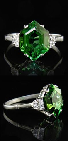An Art Deco platinum, tourmaline and diamond ring, 1930s. Set to the centre with a 1.25cm long natural green tourmaline, flanked by six diamonds. #ArtDeco #ring