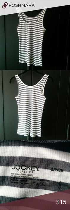 NWOT Jockey tank Unworn ribbed tank from Jockey. High cotton content and super comfortable as jockey is known for their athletic wear and sports bras. This one is striped in white and a very desaturated olive-grey. Size small but will also fit extra small. Jockey Tops Tank Tops