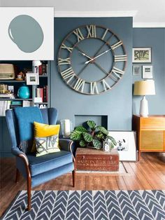 No-Fail Colors for Living Spaces. Twilight Blue wall with large clock face illustrating no-fail paint shades for living spaces. Living Room Paint and Decor Room Paint Colors, Paint Colors For Living Room, New Living Room, Living Room Interior, Living Spaces, Living Room Decor Blue Walls, Blue And Brown Living Room, Living Room Accent Wall, Small Living