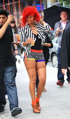 In a stripped blazer and multicolored shorts, the always eccentric dresser wows in her craziest combo yet while filming her new video in NYC! Rihanna managed to stand out even in New York City&#82…