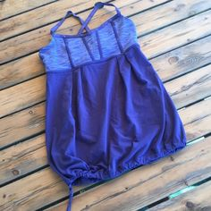 Lululemon adjustable bottom tank top Size 6 , with adjustable bottom tank top , great condition , no odor , no stain , no smoking house , color purple / blue? lululemon athletica Tops Tank Tops
