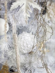 Use Textured Ornaments - 10 Tips for Creating an Elegant, All-White Christmas Tree on HGTV