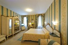 Mark's Basin, in the heart of the Venice Lagoon, Hotel Savoia & Jolanda boasts a centuries-old tradition of hospitality. Hotel Finder, Hotel Deals, Venice Italy, Hotels And Resorts, Basin, Curtains, Vacation Rentals, Bed, Furniture