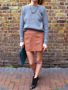Grey long sleeve sweater/shirt, tan leather skirt @ black ankle boots