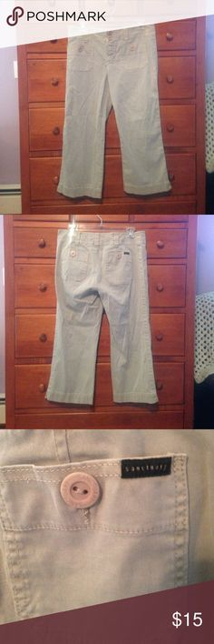 Sanctuary Clothing Sz 29 cotton khaki capris Sanctuary Clothing Sz 29 cotton khaki capris. 100% cotton machine washable. Slight flare bottom with inch split on bottom of both outer pants leg. Four pockets with buttons front and back. Sanctuary Pants Ankle & Cropped