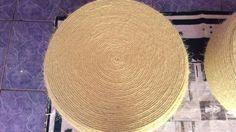 Puff de pneu e sisal, medindo 0,64 cm de largura, 0,38 cm de altura com os pés, por 2,00 de perímetro, pés de inox, produto artesanal.