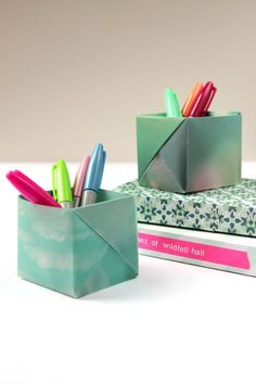 If you love free things, then practice your origami skills by making a pencil holder with paper you stole from the printer. | 39 Desk DIYs That Won't Feel Like Work