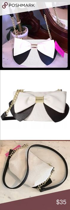 🎀Betsey Large Bow Crossbody🎀 Adorable cross body purse with one zippered interior pocket and zip closure. Shoulder strap is partially chain link and gives a little something extra. **Open to REASONABLE offers (reasonable is not half of asking price) please remember Posh takes 20%* Bundle and save on shipping! Bundle and save on shipping! Betsey Johnson Bags Crossbody Bags