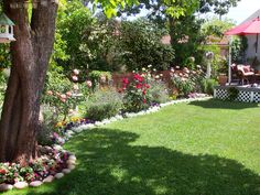 RMS user KeithC's cottage garden features a sweeping mix of roses, grasses, annuals, perennials and decorative garden art... a little bit of everything! #gardening