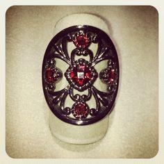 Garnet sterling silver ring with black rhodium finish. Item# 555-761 At DVVS Fine Jewelry