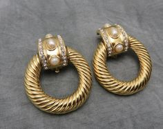Eye catching golden textured hoops and stunning faux pearl and rhinestone studs grace the beauty of Givenchy in this elegant pair of door knocker earrings. #stuff4uand4u