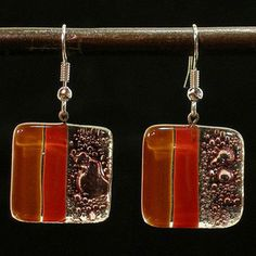 @Overstock - Modernize your accessory collection with handmade glass earrings by Chilean artist Juan Pablo Borcoski. Fashioned from fused glass, these artsy earrings are smooth and sophisticated, and the cool hanging squares are versatile enough for everyday wear.http://www.overstock.com/Home-Garden/Caramel-Strawberry-Delight-Fused-Glass-Earrings-Chile/4655189/product.html?CID=214117 $10.99