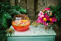 Ruffled Blog - Hawaiian themed florals and punch bowl display. Papaya, fuchsia, sea foam, lime, emerald.