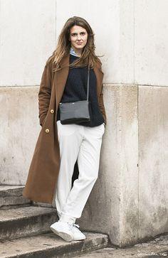 Izortze in Paris, white pants, white sneakers, brown oversize coat, grey ribbed sweater, blue button down, black cross body bag / Garance Doré