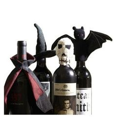 Halloween Wine Bottle Topper: The gang (Dracula, wicked witch, and more) is all here. Pop these soft toppers on your bottles to give the bar cart a ghoulish touch.