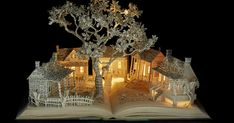 Su Blackwell is an English artist who creates fairytale-like book sculptures. She transforms flat pages into three-dimensional objects and constructs entire landscapes filled with mystery.