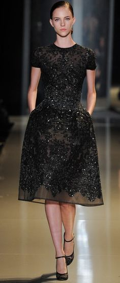 Elie Saab Spring 2013 Couture, Nicole Pollard. (Black knee length embroided dress)