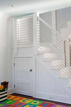 Love the hidden closet under the steps. Also like how there are two sets of stairs, with a landing, instead of one steep set.