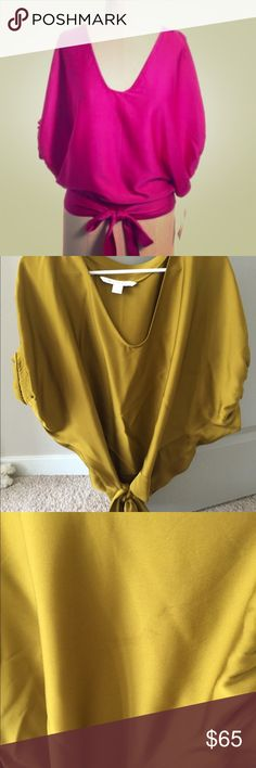 Diane Von furstenberg blouse DVF blouse size 2. Silk blouse with a tie can be worn in the front side or back. The tie has a tear that just needs a quick sew. Blouse has small stains not visible when on. Can be dressed up or down. Cute with Jeans or pants! Diane von Furstenberg Tops Blouses