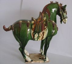 Tang Dynasty - Green base, zancai glazed horse