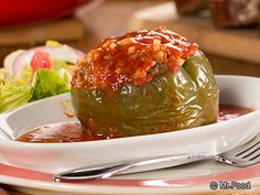 Summer Stuffed Peppers - This simple weeknight dinner is an easy way to work those veggies into your cooking. It takes about an hour to cook up all those savory, flavorful ingredients, including ground beef, rice, onions, bell peppers, and more.