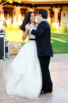 Love this Vera Wang gown! The bride wore a white sash for the ceremony and then changed to black for the party ~ http://StyleMePretty.com/texas-weddings/2012/04/09/university-of-texas-golf-club-wedding-by-hyde-park-photography/ by hydeparkphoto.com