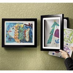 this photo frame opens to store up to 50 pictures..great way to display kids art