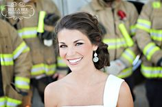 Bride surrounded by firefighters | Shared by LION