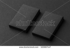Mockup of two vertical business cards stacks at black textured paper background.