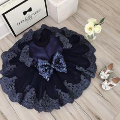 We just released a brand new color of the Julia Dress! Navy Blue!   Sizes: 0-12 years To order, go to our website: ittybittytoes.com or  1-800-998-3428  Whatsapp: +14242980948 Or chat live with us online!