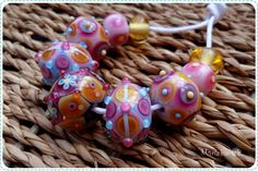 https://flic.kr/p/tLnTde   baticbeads yellowvioletblue   I like to call these kind of beads baticbeads. The lines and patterns appear as a reaction of the glass that is used. It's a slow process of carefully layering dots , melting them in and slowly watch the glass performing it's magic. Even though I already made a lot of beads this way, there's always an element of surprise in how the used colours appear.