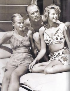 Grace as a teen with her sister & father (an olympic swimmer) in a 50's floral two-piece swim suit.