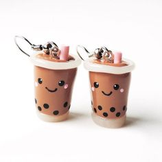 A pair of smiling tapioca-filled bubble tea drinks — because just having one is…